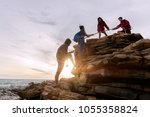male and female hikers climbing ... | Shutterstock . vector #1055358824