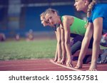 women ready to race on track... | Shutterstock . vector #1055367581
