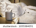 cup of morning coffee on the... | Shutterstock . vector #1055384051