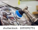 auto mechanic buffing and... | Shutterstock . vector #1055392751