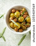 pickled green olives and...   Shutterstock . vector #1055409569