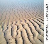 sand ripples on a beach.   Shutterstock . vector #1055413325