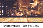 Stock photo wood table top bar with blur night cafe background lifestyle and celebration concepts ideas 1055413457