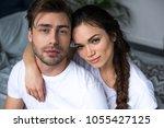 attractive woman embracing her...   Shutterstock . vector #1055427125