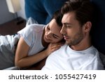 smiling man and woman tenderly... | Shutterstock . vector #1055427419