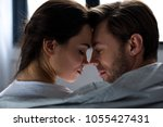 romantic man and woman tenderly ... | Shutterstock . vector #1055427431