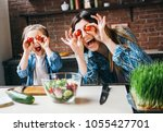 mother cook with daughter on...   Shutterstock . vector #1055427701