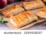 puff pastry filled with apples... | Shutterstock . vector #1055428337