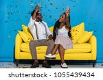 cheerful stylish young african... | Shutterstock . vector #1055439434