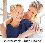 warm portrait of mother and son ... | Shutterstock . vector #1055445665