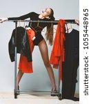 pretty girl in sexi black... | Shutterstock . vector #1055448965