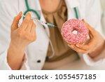 closeup on medical doctor woman ...   Shutterstock . vector #1055457185
