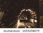 underground black coal mine... | Shutterstock . vector #1055458079