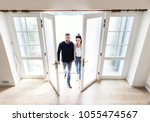 couple move to new house | Shutterstock . vector #1055474567