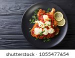 veal milanesa napolitana with... | Shutterstock . vector #1055477654