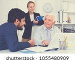 mature man is talking to... | Shutterstock . vector #1055480909