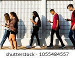 group of young teenager friends ... | Shutterstock . vector #1055484557