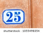 numbered tile on a wall | Shutterstock . vector #1055498354