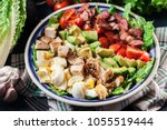 healthy cobb salad with chicken ... | Shutterstock . vector #1055519444