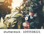 Small photo of Hand in glove with the parachutist altimeter close up.