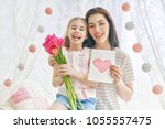 happy women's day  child... | Shutterstock . vector #1055557475