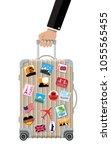travel bag in hand. plastic...   Shutterstock .eps vector #1055565455