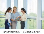 pretty female business... | Shutterstock . vector #1055575784