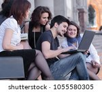 group of fellow students with... | Shutterstock . vector #1055580305