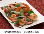 Shrimp and spinach salad with grape tomatoes and balsamic mustard vinaigrette - stock photo