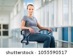 female patient  sitting in a... | Shutterstock . vector #1055590517