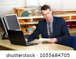 a young  manager working on a... | Shutterstock . vector #1055684705