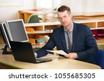a young  manager working on a... | Shutterstock . vector #1055685305