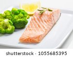 steamed salmon and broccoli on... | Shutterstock . vector #1055685395