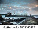 big wave hit the jetty of la... | Shutterstock . vector #1055688329