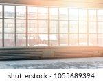 industrial interior with wide... | Shutterstock . vector #1055689394