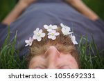 sleeping hipster lying in tall... | Shutterstock . vector #1055692331