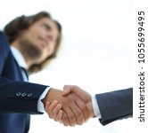 Small photo of Successful business people handshaking after good deal.