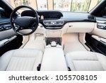 luxury car interior. steering... | Shutterstock . vector #1055708105
