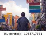 rear view of a backpacker...   Shutterstock . vector #1055717981