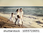happy young family in white... | Shutterstock . vector #1055723051