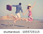 couple on beach with travel bag ... | Shutterstock . vector #1055725115