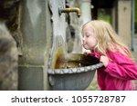 adorable little girl playing... | Shutterstock . vector #1055728787