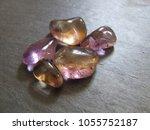 ametrine tumbled pebbles on... | Shutterstock . vector #1055752187