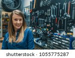 female bicycle mechanic. female ... | Shutterstock . vector #1055775287