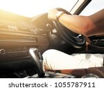 man driving car hand on...   Shutterstock . vector #1055787911