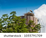 stork's nest  stork on the roof ... | Shutterstock . vector #1055791709