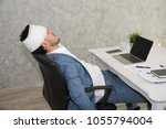 sick business man wearing... | Shutterstock . vector #1055794004