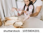 close up view of the bakers are ... | Shutterstock . vector #1055804201