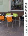Small photo of cafe bistro table chairs seating on a holiday springtime afternoon in south germany historical city