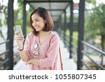asia woman using with smart... | Shutterstock . vector #1055807345